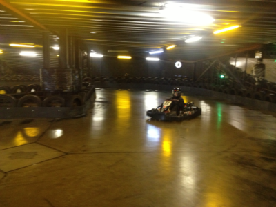 A member of Groups A & B driving their Go Kart.