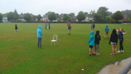-- Group B playing rounders in the rain.