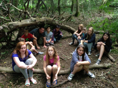 Group B building shelters in the woods.
