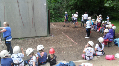 Groups D & E (and some of the leaders!) equipped and ready for the Abseil Wall.
